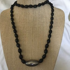 Black beaded necklace with silver bead